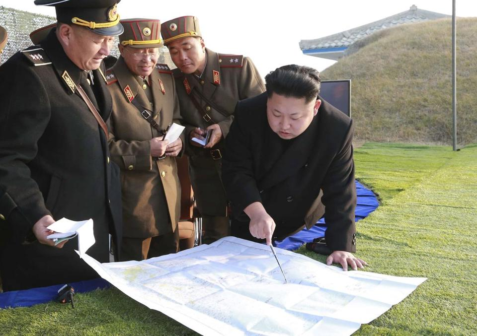 Kim Jong Un points at something important. Photo: Reuters